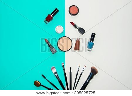 Set cosmetics makeup brush eye shadow and lipstick colourful background. Lifestyle Concept