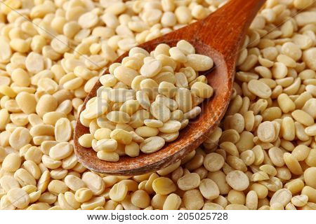 Close up of uncooked split de skined white Urad daal or lentils