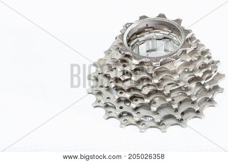 Road bike cassette spare parts on white background