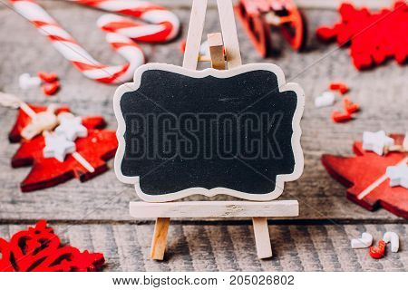 Chalkboard and Holiday Christmas Red Decoration. Copy Space Top view Frame