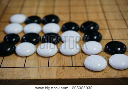 Go. Traditional asian strategy board game.  Desk for board game Go and black and white bones.
