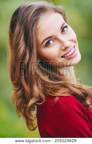 Beautiful Face Of Young Woman. Outdoor Portrait In Autumn Park