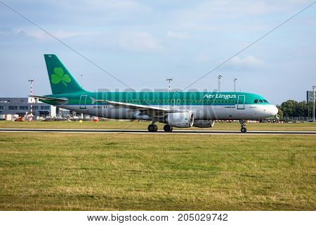 PRAGUE CZECH REPUBLIC - SEPTEMBER 20 2017: A320 Aer Lingus taxis to terminal at PRG Airport. Aer Lingus is the national flag carrier of Ireland. It operates a fleet of Airbus aircraft.