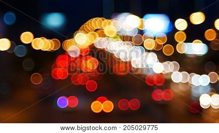 Abstract colorful bokeh light of the car background.
