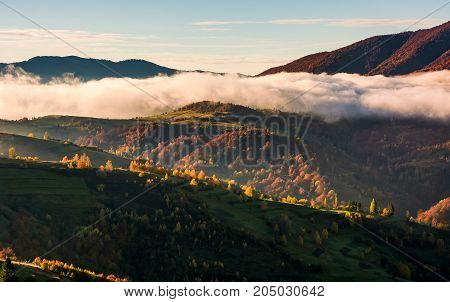 Cloud Rising Above The Rolling Hills In Autumn