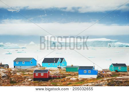Colorful Houses And Bay With Icebergs, Greenland
