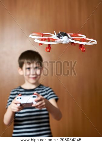 Happy Little Boy Drives Toy Quadcopter Drone