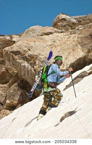 Freerider climbing a mountain, Caucasus, Elbrus, summer