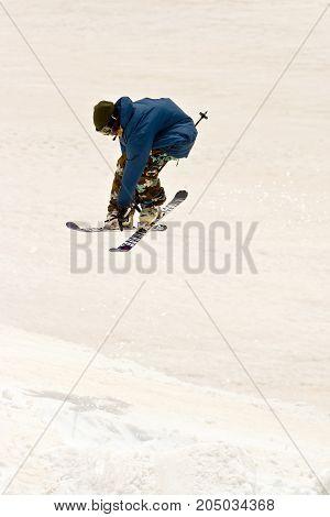 Freerider jumping in a mountains, Caucasus, Elbrus summer