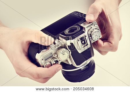 Retro Slr Camera In Hands Of Photographer Closeup