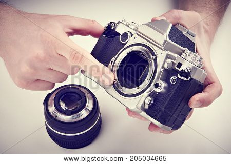 Photographer Shows The Mechanism Of Auto Focus Slr Camera