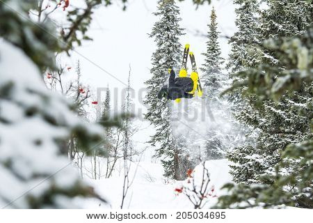 Freerider jumping in the mountains in Siberia