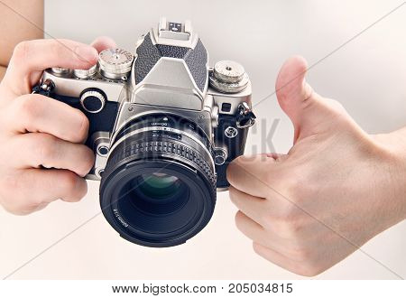 Gesture Thumbs Up And Retro Slr Camera Isolated