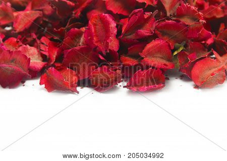 A pile of autumn leaves with red color paint is dried leaves on a white color background. Floral and leaves concept. copy space for decorative writing text.
