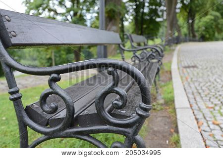 Old metal vintage benches with wood in raw paint in black