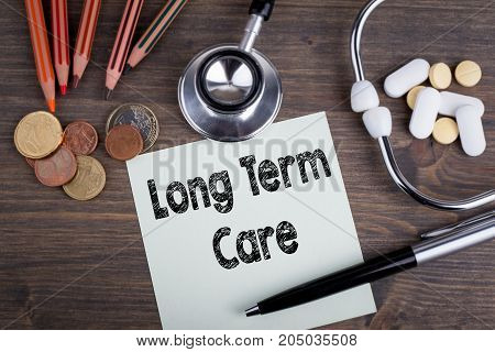 long term care concept. Desk with stetascope, money and tablets. background for medical care.