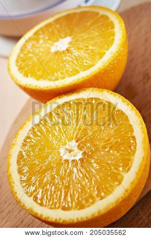 Juicy Bisected Oranges Closeup On Wooden Board Vertical