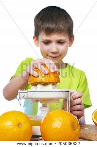 Happy Boy With Oranges Makes Juice In Juicer Isolated