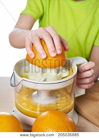 Boy With Oranges Makes Juice In Juicer Isolated