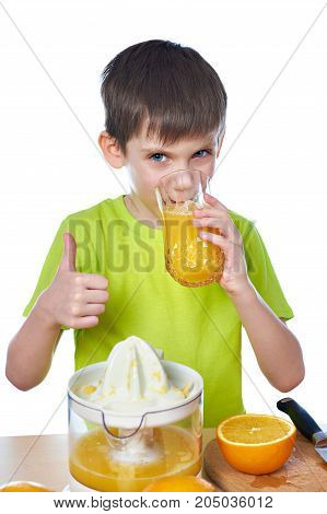 Happy Boy Drinks Juice And Showing Thumbs Up Isolated