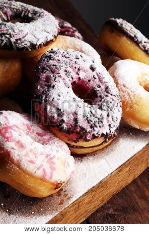 Assorted Donuts With Chocolate Frosted, Pink Glazed And Sprinkle