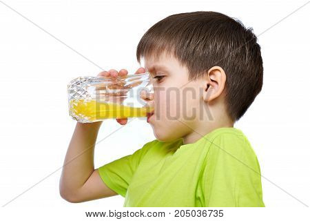 A boy drinks orange juice isolated white