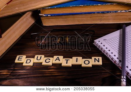 Notepad, Pencil And Eyeglasses In Front Of Books. Education Inscription