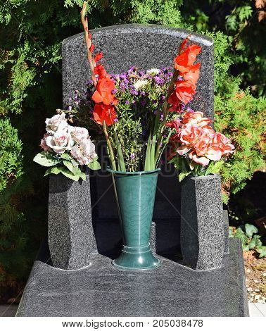 Tombstone in the public cemetery in summer