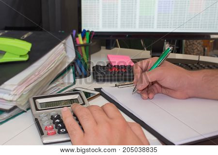 businessman financial inspector and secretary making report calculating or checking balance. Internal Revenue Service inspects checks document with a laptop computer and calculator. Audit concept