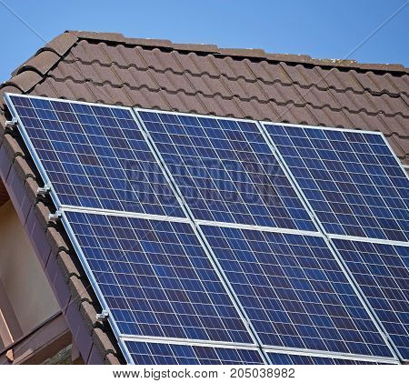 Solar panels on the roof of a house in the city