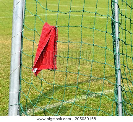 A towel on the net of the goal post