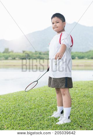 Obese Fat Boy Playing Badminton