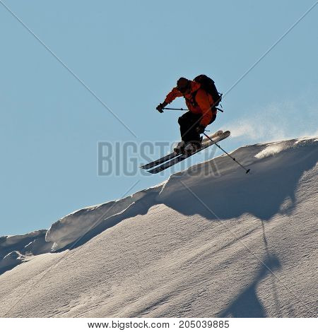 The young man skiing in the Caucasus mountains