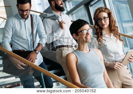 Portrait of attractive businesspeople having free time from work