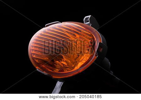 A Car Headlight On A Black Background