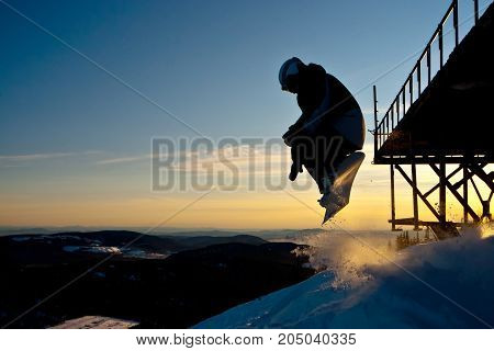 The snowboarder jumping from the bridge in Siberia