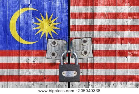 Malaysia flag on door with padlock close