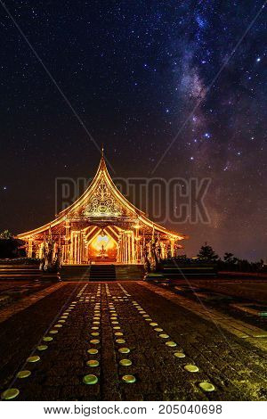 Beautiful Sirindhorn Wararam Phu Prao Temple ( Wat Phu Prao ) with spectacular Milky Way background at night Ubon Ratchathani province Thailand