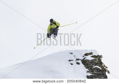 Freerider jumping from the steep. Mountains of Kamchatka