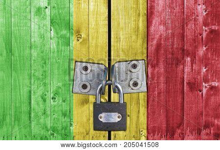 Mali flag on door with padlock close