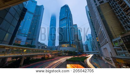 Hong Kong cityscape at twilight Business downtown Morning scene and the mist.