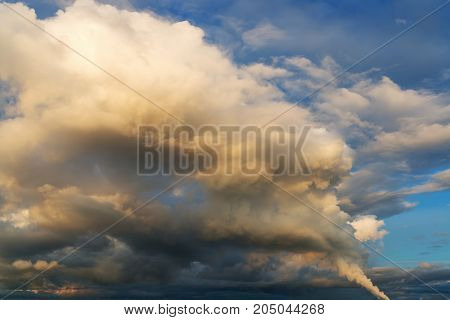 Fantastic soft white clouds and thunderclouds against blue sky, natural composition