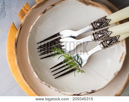 Plates and forks for a meal. Laying the table