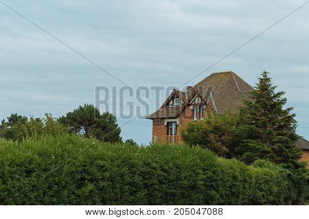 Country Houses With Sea View In The Region Of Normandy, France On A Cloudy Day. Beautiful Countrysid