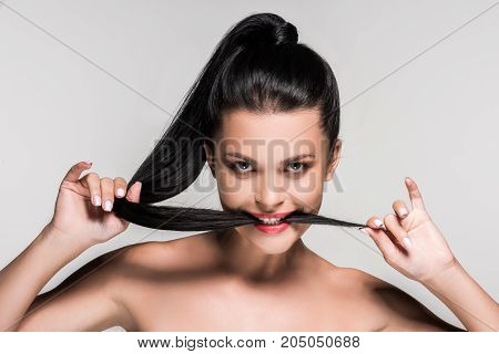 Woman With Hair In Mouth