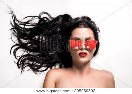 Young Woman In Red Eyeglasses