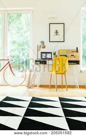 Spacious Workspace With Yellow Chair