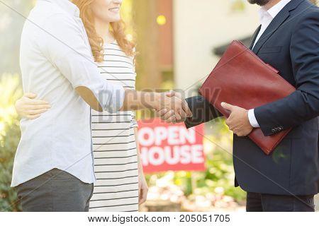 Real Estate Advisor Congratulating Clients