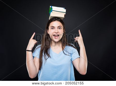 Happy Young Woman Holding Books On Her Head