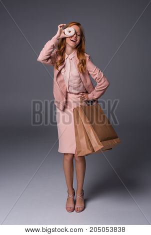 Girl With Donut And Shopping Bags